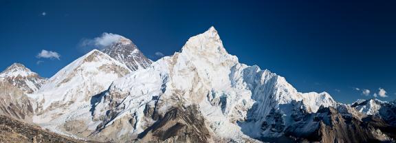 Female trekker looks over Himalayas